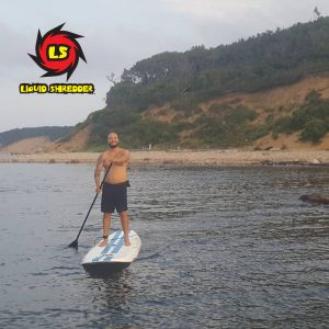 Image of an EZ Slider Paddleboard in use on a lake