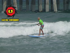 SUP surfing at the pier